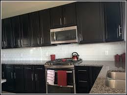 white backsplash dark cabinets glass subway tile backsplash with dark cabinets tiles home