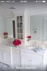 the master bathroom has black granite countertops with double