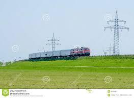 german train driving on hindenburg dam towards the island sylt