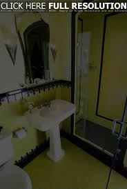art deco bathroom yellow and black tiles with walk in tub and art