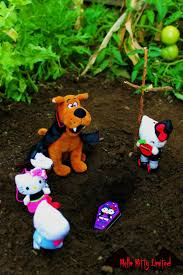 hello kitty scooby doo snoopy funeral halloween by