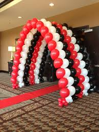 casino tunnel of balloons in red white and black casino theme