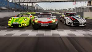 british racing green porsche journalists test a trio of racing cars