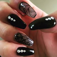 beautifully done ballerina shaped nails in black gel polished with