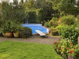 pool landscaping ideas what to consider before landscaping by a swimming pool
