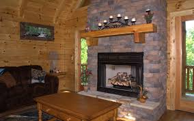 houses cabin fireplace sitting place candles wooden stone small