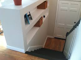 built in shelves in a split level foyer found at http www