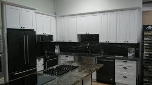 white cabinets with black countertops and appliances kitchen remodel appliance bundle deals name brand discount