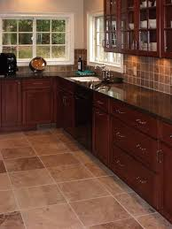 kitchen floor ideas with cabinets awesome cherry kitchen cabinets with travertine tile floor and