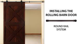 Erias Home Designs Top Of Door Sliding Barn Door Hardware by How To Install The Rolling Barn Door Simple Smooth Oh So Easy