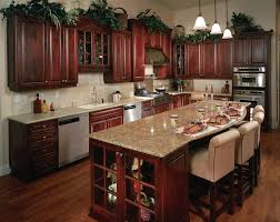 pictures of kitchens with cherry cabinets yellow kitchen painting