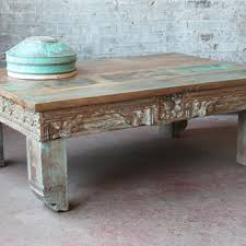 carved wood coffee table shop carved coffee table on wanelo