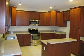 brown cherry wood kitchen cabinet and kitchen island with white