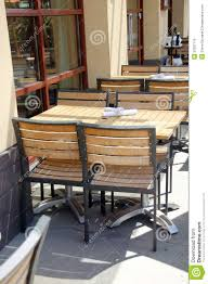 wooden tables and chairs in outdoor restaurant stock photo image