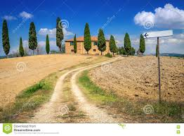 brick house in the countryside of tuscany italy the path leading