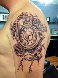 grey ink clock and rose tattoos on shoulder clock shoulder