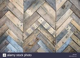 weathered wood wall background fitted with herringbone pattern