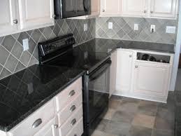 granite countertop oak cabinet pulls red kitchen wall tiles
