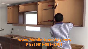 how to update mobile home kitchen cabinets installing kitchen cabinets into your mobile home