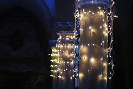 file warm white led lights attached to pillars for a wedding jpg