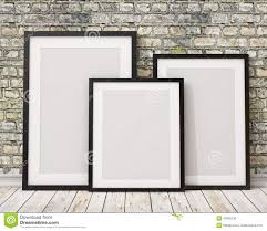 mock up three blank black picture frames on the old brick wall and