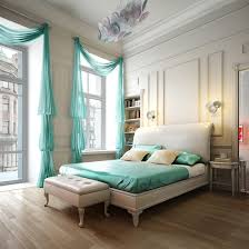interior turquoise window treatment ideas facing white bedding