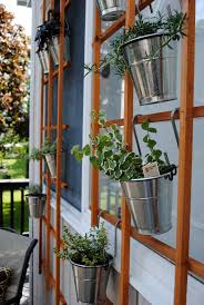 Hanging Flower Pot Hooks Container Garden Using An Outdoor Trellis Hooks And Pots From