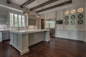 white kitchen cabinets with wood beams kitchen with x mullion cabinets transitional kitchen