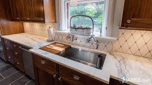 wood kitchen cabinets with white countertops best way to pair countertops with cabinets marble