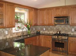 maple cabinet kitchen ideas u shaped kitchen with maple cabinets and grey tile backsplash