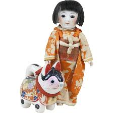 antique japanese bisque doll in traditional kimono with lucky cat