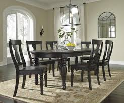 sharlowe oval dining room extension table in charcoal gray by