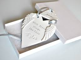 with brave wings she flies clay ornament with wings and