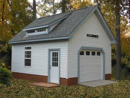 beautiful garage with transom windows and dormer with brick skirt
