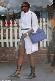 ej johnson in white shirt dress and gladiator sandals at la