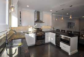 white shaker cabinets wine fridge and draw microwave kitchens