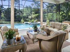 Outdoor Furniture Naples by Covered Lanai Wood Ceiling Fireplace And Summer Kitchen Grey