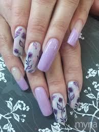 long nails with lilac polish and purple nail art myria
