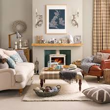 white fabric sofa and brown leather chair combined with brown