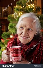 what to get an elderly woman for christmas elderly woman cup tea near christmas stock photo 247772767