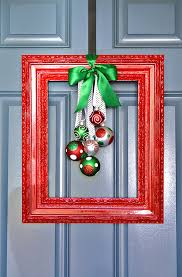 Christmas Ornaments In Bulk by Hang Christmas Ornaments From An Old Picture Frame With Ribbon