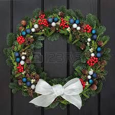 White Bow Christmas Decorations christmas wreath with red bauble decorations and bow holly