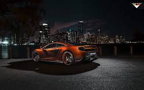 orange mclaren wallpaper orange mclaren mp4 12c against the backdrop of the city at night