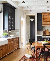 wood tone kitchen cabinets 15 two tone kitchen cabinet combos you ll want to try