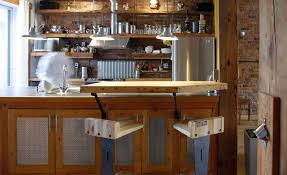 architecture industrial kitchen with breakfast bar and brick industrial kitchen with breakfast bar and brick walls also exposed brick plus kitchen island with open shelves and pendant lighting plus portable bars also