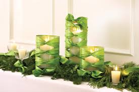 decorations white candles on the cylinder glass with green