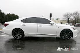 white lexus lexus ls460 with 22in vossen vfs1 wheels exclusively from butler