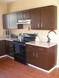 kitchen laminate cabinets if you cant love your laminates paint em kitchen cabinet ideas