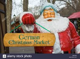 figure holding german market sign at