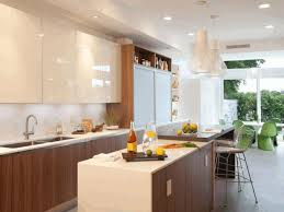 kitchen island with storage cabinets modern black cabinets yellow exposed shelves integrated metal